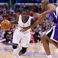 23 November 2013: Los Angeles Clippers point guard Darren Collison (2) drives past Sacramento Kings small forward Travis Outlaw (25) during the Los Angeles Clippers 103-102 victory over the Sacramento Kings at the Staples Center, Los Angeles, California, USA.