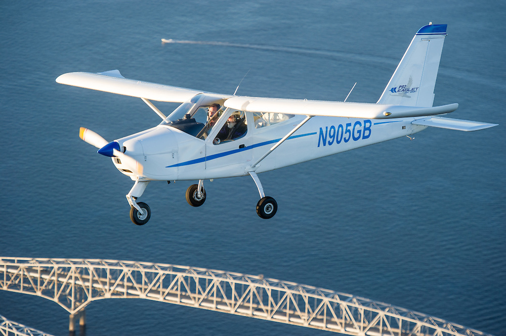 Chesapeake Sport pilot aircraft, Technam Eaglet, RV-12 flying over the Chesapeake Bay Bridge in Maryland.