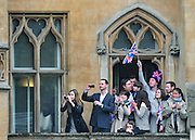 A crowd watches from a balcony as Kate Middleton arrives at Westminster Abbey for her wedding to Prince William in London on April 29, 2011. UPI/Kevin Dietsch