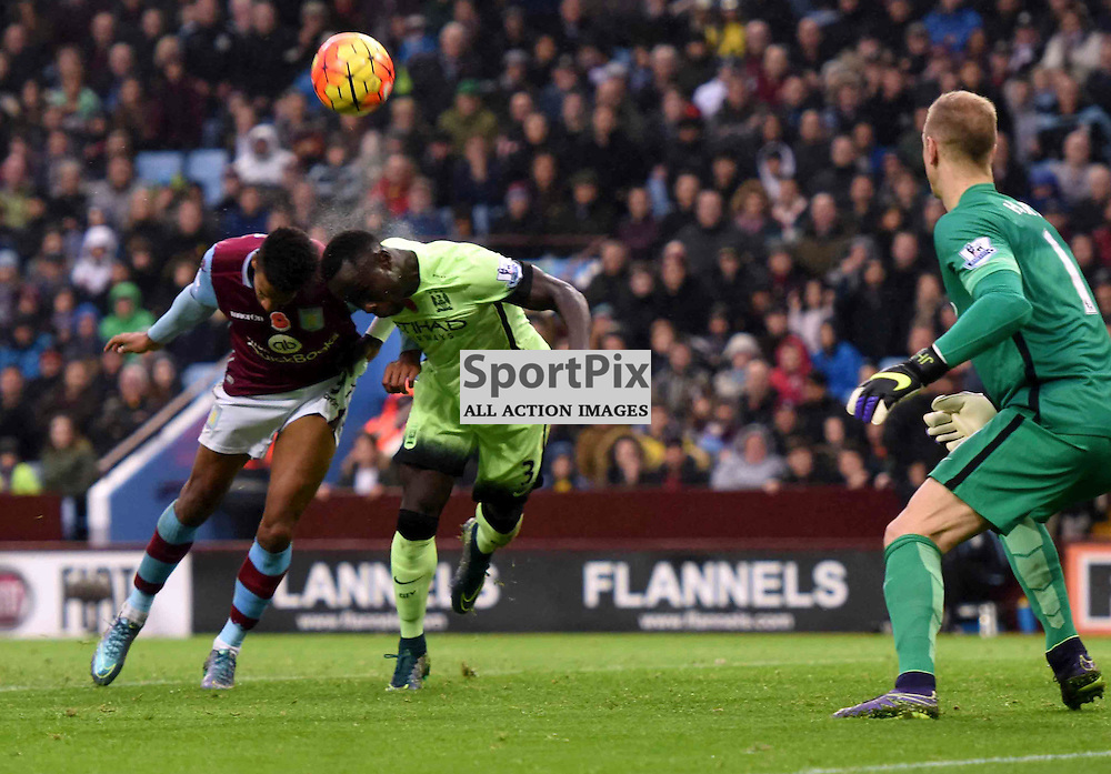 Scott Sinclair of Villa and Bacary Sagna go for the ball