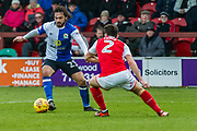 Blackburn Rovers Bradley Dack (23) and Fleetwood Town Lewie Coyle (2) during the EFL Sky Bet League 1 match between Fleetwood Town and Blackburn Rovers at the Highbury Stadium, Fleetwood, England on 20 January 2018. Photo by Michal Karpiczenko.