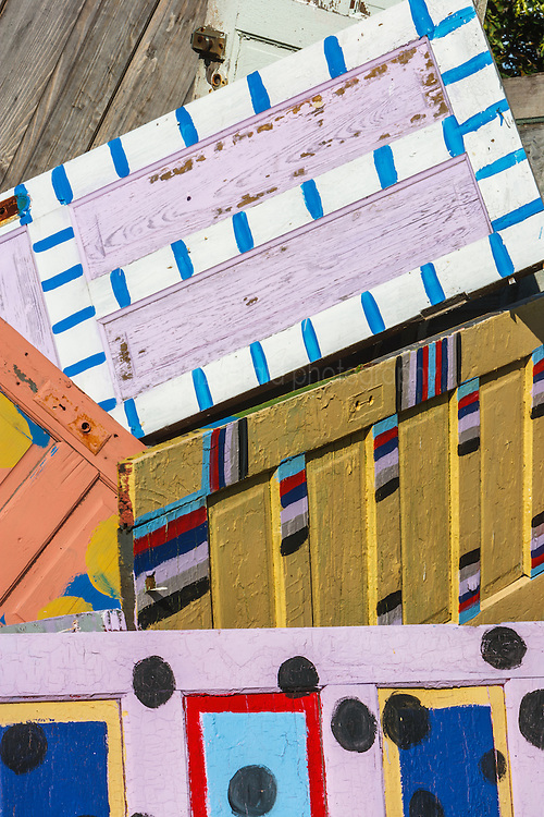 Painted doors, stacked at the Heidelberg Project, Detroit, Michigan.  The Heidelberg Project is a grass roots project started by artist Tyree Guyton that uses art to help revitalize the embattled neighborhood.  Each year, over 275,000 people visit the project .  For more information, go to www.heidelberg.org