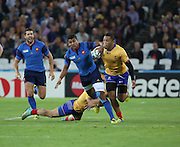 Wesly Fofana (France) trying to make a break for it but getting tackled at the last minute during the Rugby World Cup Pool D match between France and Romania at the Queen Elizabeth II Olympic Park, London, United Kingdom on 23 September 2015. Photo by Matthew Redman.