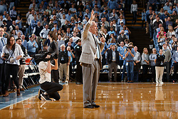 CHAPEL HILL, NC - JANUARY 20: Head coach Roy Williams of the North Carolina Tar Heels speaks as former player Justin Jackson of the Tar Heels is recognized at half time for having his jersey honored in the rafters of the Dean Smith Center during a game against the Georgia Tech Yellow Jackets on January 20, 2018 at the Smith Center in Chapel Hill, North Carolina. North Carolina won 80-66. (Photo by Peyton Williams/UNC/Getty Images) *** Local Caption *** Roy Williams