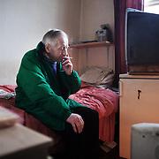 Mik in his bedsit in Hackney.
