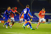 Uche Ikpeazu of Blackpool FC (On loan from Watford FC) barges his way through during the Sky Bet League 1 match between Oldham Athletic and Blackpool at SportsDirect.Com Park, Oldham, England on 15 March 2016. Photo by Mike Sheridan.
