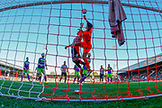Brentford's Neal Maupay challenges City's Goalkeeper Max O'Leary during the EFL Sky Bet Championship match between Brentford and Bristol City at Griffin Park, London, England on 20 October 2018.