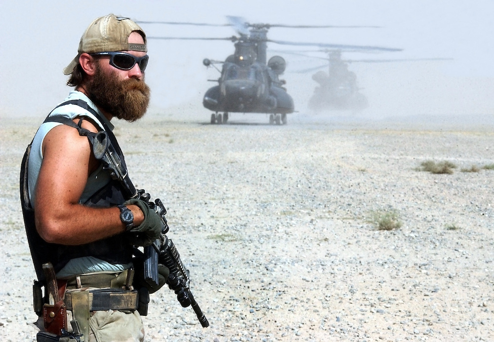 TALOQUAN, NORTHERN AFGHANISTAN - AUGUST 28: U.S. Army Special Forces soldier nicknamed 'Cowboy' secures an airstrip during an operation August 28, 2002 in the town of Taloquan in Northern Afghanistan.