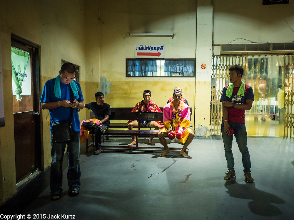 27 JULY 2015 - BANGKOK, THAILAND:  Boxers wait for their matches to start at Rajadamnern Boxing Stadium (also spelled Ratchadamnoen Stadium). It is Bangkok's oldest venue for Muay Thai. It hosts bouts on Monday, Wednesday, Thursday and Sunday. Ringside seats are about 2,000 Thai Baht (approximately $57 US). The stadium hosted its first fight in December, 1945.        PHOTO BY JACK KURTZ