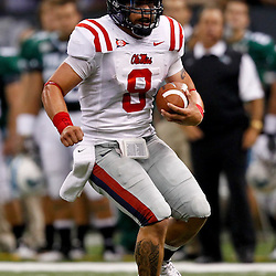 Sep 11, 2010; New Orleans, LA, USA; Mississippi Rebels quarterback Jeremiah Masoli (8) runs with the football during a game against the Tulane Green Wave at the Louisiana Superdome. The Mississippi Rebels defeated the Tulane Green Wave 27-13.  Mandatory Credit: Derick E. Hingle