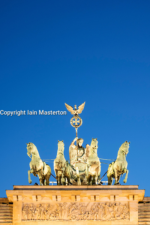 Detail of Quadriga on top of Brandenburg Gate in the evening in Berlin Germany