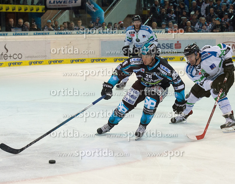 18.12.2015, Keine Sorgen Eisarena, Linz, AUT, EBEL, EHC Liwest Black Wings Linz vs HDD TELEMACH Olimpija Ljubljana, 32. Runde, im Bild Rob Hisey (EHC Liwest Black Wings Linz) vor Anze Ropret (HDD TELEMACH Olimpija Ljubljana) // during the Erste Bank Icehockey League 32nd round match between EHC Liwest Black Wings Linz and HDD TELEMACH Olimpija Ljubljana at the Keine Sorgen Icearena, Linz, Austria on 2015/12/18. EXPA Pictures © 2015, PhotoCredit: EXPA/ Reinhard Eisenbauer