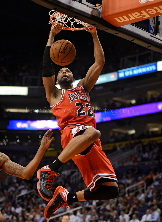 Nov. 14, 2012; Phoenix, AZ, USA; Chicago Bulls forward Taj Gibson (22) dunks the ball during the game against the Phoenix Suns in the first half at US Airways Center. Mandatory Credit: Jennifer Stewart-US PRESSWIRE.