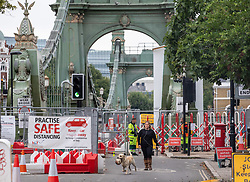 © Licensed to London News Pictures. 14/08/2020. London, UK. A Walk goes around Hammersmith Bridge which crosses the River Thames in West London after Fulham Council suddenly closed it to all traffic Thursday night due to safety concerns. Hammersmith Bridge has been close to all traffic including pedestrians, cyclists and boats going under it after cracks in the bridge have become larger by the heatwave. Photo credit: Alex Lentati/LNP