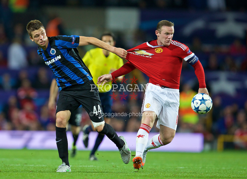 MANCHESTER, ENGLAND - Tuesday, August 18, 2015: Manchester United's captain Wayne Rooney in action against Club Brugge's Brandon Mechele during the UEFA Champions League Play-Off Round 1st Leg match at Old Trafford. (Pic by David Rawcliffe/Propaganda)2
