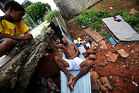A young boy looks upon a homeless man sleeping in an area populated by crack addicts in San Miguel, a poor barrio in Panama City, Panama on Saturday, September 8, 2007. (Photo/Scott Dalton).