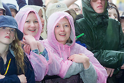 Fans in the rain at the main stage on the 8th July at the T in the Park music festival, held at Balado, Kinross in Fife, Scotland, on the weekend of Saturday 8 July and Sunday 9 July 2000..