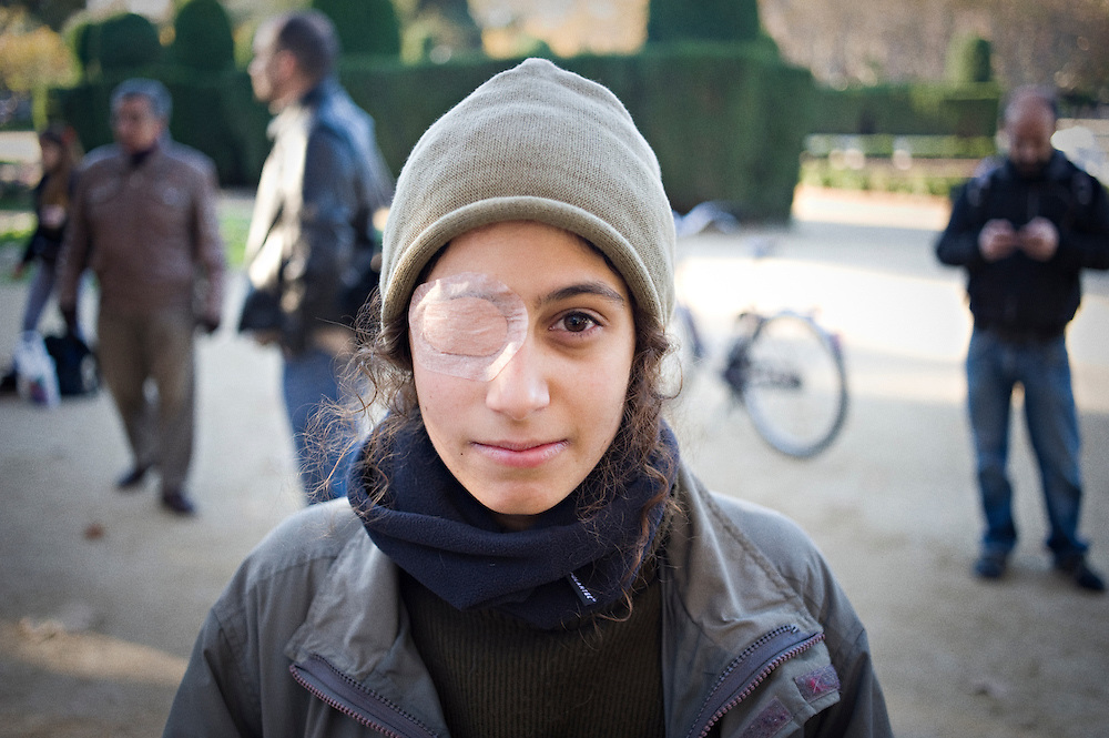 04-12-2012, Barcelona, Spain - Demonstrator wearing an eye patch during protest in front of the Catalan Parliament against the use of rubber bullets by the police. The latest rubber bullet victim was Ester Quintana, a 42 years old unemployed woman that lost her left eye during the last general strike on November 14th in Barcelona.