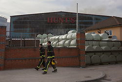 © licensed to London News Pictures. London, UK 12/08/2012. Fire damage seen on Hunt's recycling centre as 200 firefighters and 40 fire engines called to a fire incident at a recycling centre on Chequers Lane in Dagenham, east London on 12/08/12. Photo credit: Tolga Akmen/LNP