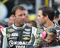 Mar 17, 2013; Bristol, TN, USA; NASCAR crew chief Chad Knaus talks with driver Jimmie Johnson (48)before the Food City 500 at Bristol Motor Speedway. Kasey Kahne won the race. Mandatory Credit: Randy Sartin-USA TODAY Sports