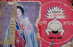 "DAN, NEPAL, APRIL 24, 2004: A poster of the Queen of Nepal is covered by advertisements on a wall near Dan, in Western Nepal April 24, 2004. Support for the monarchy is lowasMaoist guerrillas' fightforacommuniststate.Analysts and diplomats estimate there about 15,000-20,000 hard-core fighters, including many women, backed by 50,000 ""militia"".  In their remote strongholds, they collect taxes and have set up civil administrations, and ""people's courts"" to settle rows. They also raise money by taxing villagers and foreign trekkers. Though young, they are fearsome fighters and  specialise in night attacks and hit-and-run raids. They are tough in Nepal's rugged terrain, full of thick forests and deep ravines and the 150,000 government soldiers are not enough to combat this growing movement that models itself after the Shining Path of Peru. (Ami Vitale/Getty Images)"