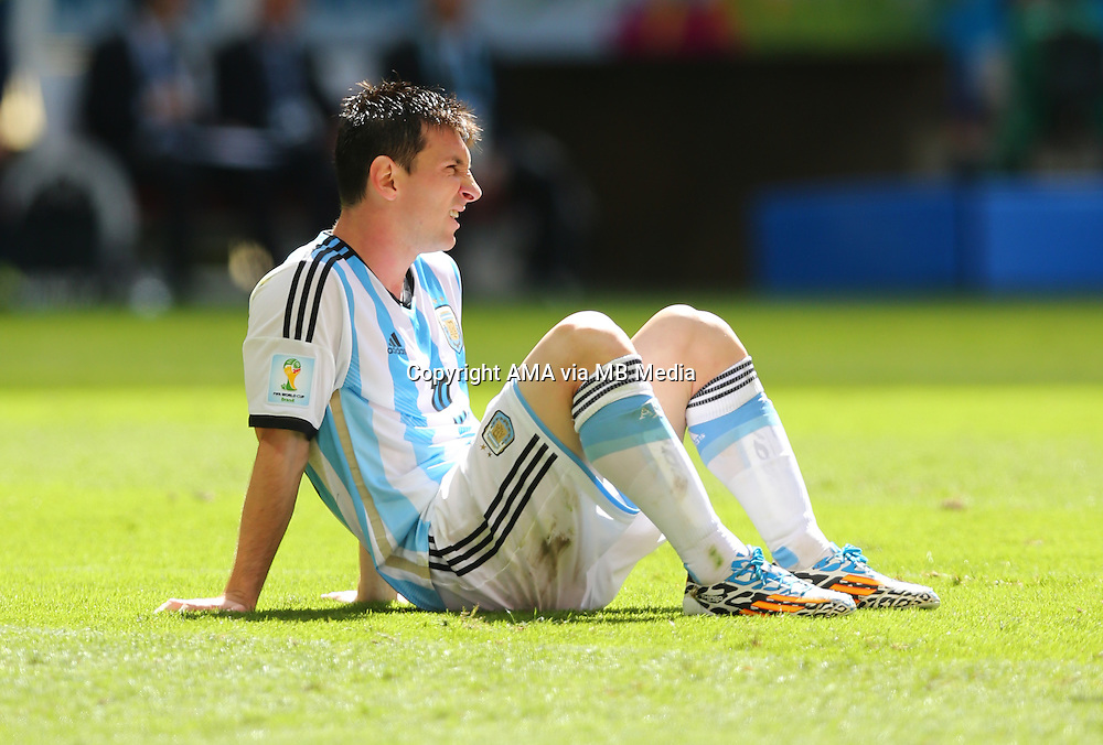 Lionel Messi of Argentina sits on the pitch