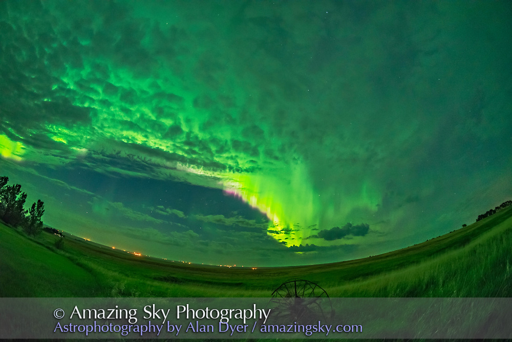 The great all-sky aurora of the night of May 27/28, 2017, shot from home in southern Alberta looking east toward a bright developing curtain along the auroral oval. The curtain is fringed with pink from glowing nitrogen. The greens, here bright enough to light the ground, are from oxygen. <br /> <br /> This is a stack of 8 exposures for the ground to smooth noise, and one exposure for the sky, all 1.6-second exposures at f/2.8 with the 12mm Rokinon full-frame fish-eye lens and Nikon D750 at ISO 3200. Shot as part of a time-lapse sequence.