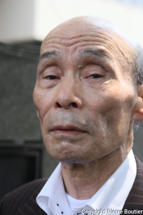 July 14, 2016 ,Tokyo , Death penalty survivor but still considered guilty for a crime he didn't commit  at Sayama city 50 years before , Kazuo Ishikawa set  up a standing demo front of Tokyo court for ending discrimination to Burakumin people considered like Japanese untouchable community ,and for innocent recognition of his case .Pierre Boutier