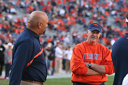 UVA head coach Al Groh (right) talks with Ron Prince before the start of the GT game.  The Virginia Cavaliers defeated the Georgia Tech Yellow Jackets 27-17 on November 12, 2005 at Scott Stadium in Charlottesville, VA.