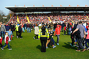 Fans being evacuated from the Stagecoach stand after a fire alarm went off during the Sky Bet League 2 match between Exeter City and Carlisle United at St James' Park, Exeter, England on 12 March 2016. Photo by Graham Hunt.