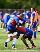 Samoan players take part in a drill during the Samoa team training session in preparation for the Rugby World Cup at the University of Brighton, Brighton and Hove, England on 18 September 2015. Photo by David Charbit.