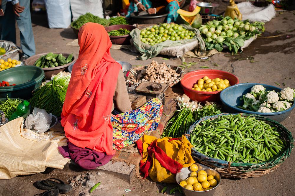 Vegetable seller in street market (India)