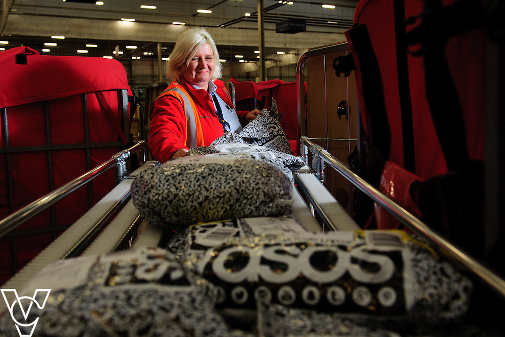Pictured is Gail Kitchen sorting some of the ASOS parcels as they are brought into the centre<br /> <br /> The team at the Royal Mail's Yorkshire Delivery Centre have won a lucrative new contract with online retail giants ASOS with the Tracked 48 product.<br /> <br /> Date: December 2, 2015