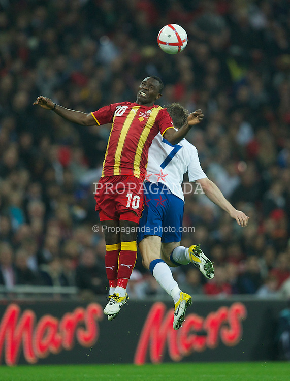 LONDON, ENGLAND - Tuesday, March 29, 2011: England's James Milner in action against Ghana's Kwadwo Asamoah during the international friendly match at Wembley Stadium. (Photo by David Rawcliffe/Propaganda)