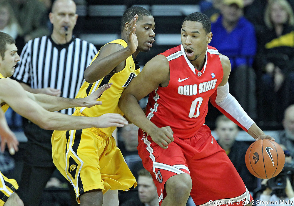 January 07, 2011: Ohio State Buckeyes forward Jared Sullinger (0) tries to drive against Iowa Hawkeyes forward Melsahn Basabe (1) during the the NCAA basketball game between the Ohio State Buckeyes and the Iowa Hawkeyes at Carver-Hawkeye Arena in Iowa City, Iowa on Saturday, January 7, 2012.