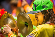 "05 JULY 2014 - BANGKOK, THAILAND:  A woman plays the cymbals during a parade for vassa in Bangkok. Vassa, called ""phansa"" in Thai, marks the beginning of the three months long Buddhist rains retreat when monks and novices stay in the temple for periods of intense meditation. Vassa officially starts July 11 but temples across Bangkok are holding events to mark the holiday all week.   PHOTO BY JACK KURTZ"