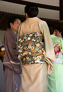 Women dressed in elaborate kimonos at the Tenryu-ji Zen Garden, Kyoto, Japan