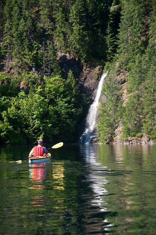 Waterfall and Kayaker, Ross Lake National Recreation Area, North Cascades National Park, Washington, US