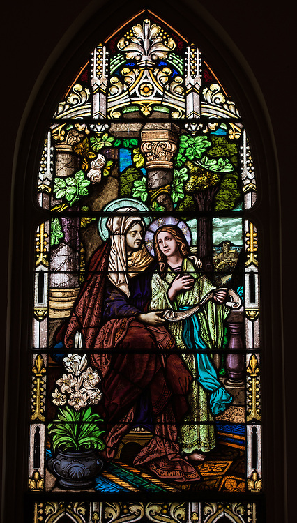 Stained glass window at St. Mary Church in Bear Creek, Wis., depicts a young Mary with her mother St. Anne. (Sam Lucero photo)
