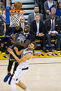 Golden State Warriors forward Draymond Green (23) is fouled at the rim by the Dallas Mavericks at Oracle Arena in Oakland, California, on February 8, 2018. (Stan Olszewski/Special to S.F. Examiner)