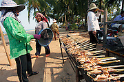 Grilling squid at the crab market. The coastal town of Kep in the 1950's and 60's was the most exclusive retreat for the elite of Cambodia. Large villas, including those of the Kings and Prime Minister, dotted this untouched coastline. Then the Khmer Rouge took power and all the villas were either destroyed or left to the jungle, many even today remain in a dilapidated state. But now Kep is rising again and with careful planning may return to its former glory as Cambodia's most exclusive retreat.