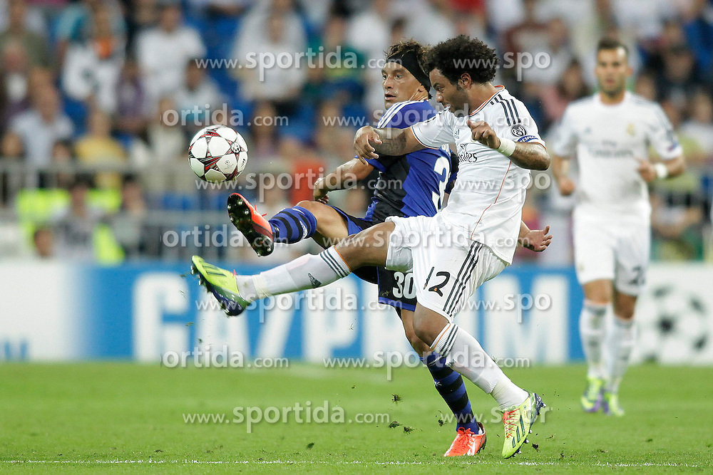 02.10.2013, Estadio Santiago Bernabeu, Madrid, ESP, UEFA Champions League, Real Madrid vs FC Kopenhagen, Gruppe B, im Bild Real Madrid Marcelo (B) and FC Kopenhagen Christian Bolanos (F) // during the UEFA Champions League Group B match between Real Madrid and FC Kopenhagen at the Estadio Santiago Bernabeu, Madrid, Spain on 2013/10/02. EXPA Pictures &copy; 2013, PhotoCredit: EXPA/ Alterphotos/ Ricky Blanco<br /> <br /> ***** ATTENTION - OUT OF ESP and SUI *****