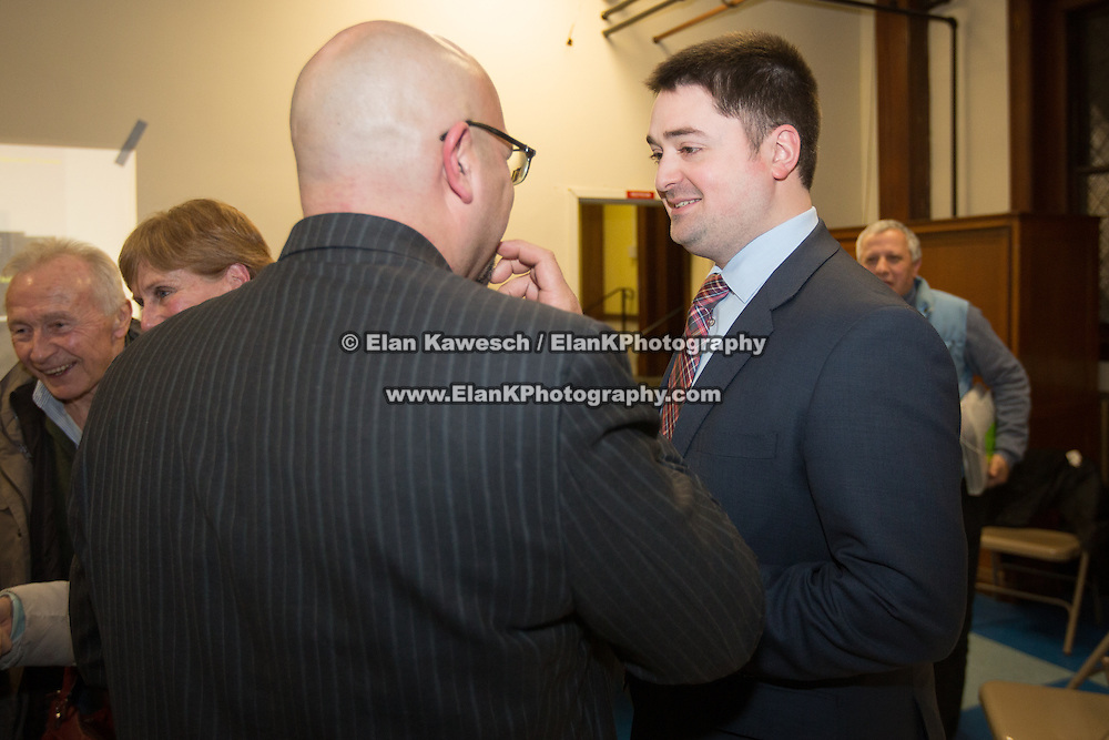 Boston City Councilor Josh Zakim speaks with Representative Jeffery Sanchez following a meeting regarding a new Mission Hill building development project at The Mission Church on January 22, 2015 in Boston, Massachusetts. (Photo by Elan Kawesch/The Times of Israel)