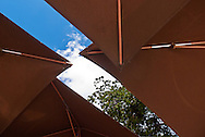 View up towards the sky of umbrellas covering tables in an outdoor cafe. WATERMARKS WILL NOT APPEAR ON PRINTS OR LICENSED IMAGES.