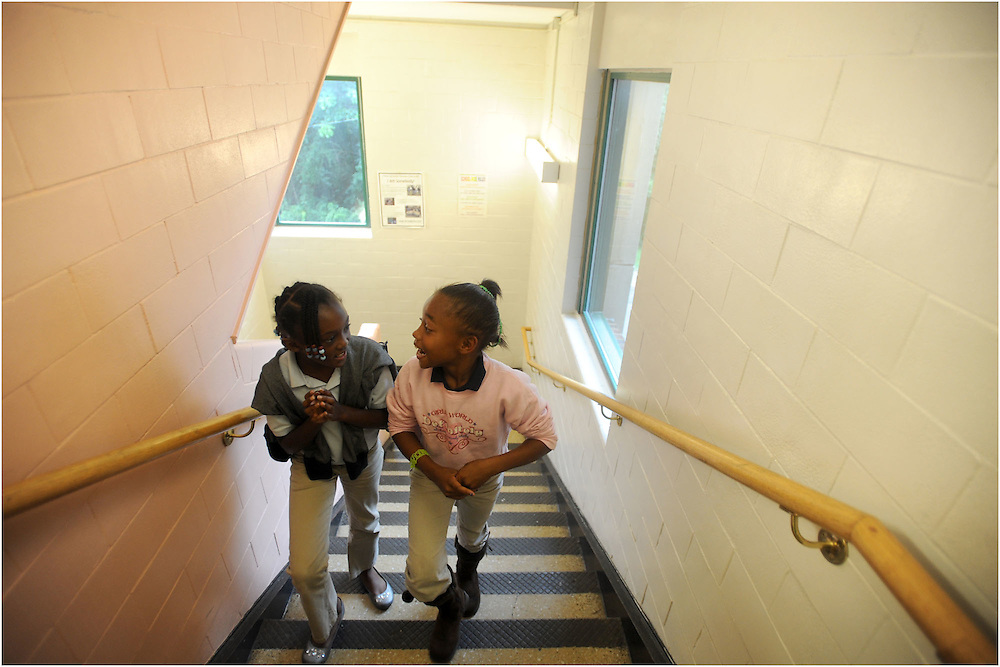 Daysia Coles (right) and Laura Robertson walk through the halls of Bass Elementary.  The school offers programs such as Bass Academy, which provides homework help and computer labs.