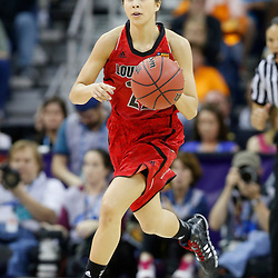 Apr 9, 2013; New Orleans, LA, USA; Louisville Cardinals guard Jude Schimmel (22) dribbles against the Connecticut Huskies during the second half of the championship game in the 2013 NCAA womens Final Four at the New Orleans Arena. Mandatory Credit: Derick E. Hingle-USA TODAY Sports