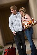 Couple Holding Luggage