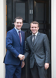 © Licensed to London News Pictures. 18/11/2014. Westminster, UK. British Chancellor George Osborne meets French Minister of Economy Emmanuel Macron at NO.11 this morning.   Ministers and MP's on Downing Street 18th November 2014. Photo credit : Stephen Simpson/LNP