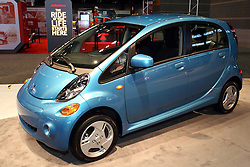 "12 February 2015:  2015 MITSUBISHI i MiEV: Building on the company's more than 35 years of involvement in advanced electric vehicle development, Mitsubishi Motors highlights the 100% electric-powered ""i MiEV"" at the 2015 Chicago Auto Show. The zero tailpipe emission ""i"" is the first North American production vehicle to be powered by Mitsubishi innovative Electric Vehicle (MiEV) technology and single fixed reduction gearbox. This system replaces the conventional engine, transmission and fuel tank with a lithium-ion battery system, motor, inverter and other EV components. At a starting MSRP of $22,995, which drops down to only $15,495 after receiving the Fed tax credit of $7,500, the iMiEV becomes one of the cheapest all-electric cars offered in North America. The long wheelbase is a feature of the rear-midship layout, which provides space for high capacity lithium-ion batteries under the floor, a roomy four-passenger cabin and 13.0 cu. ft. luggage compartment in the rear. Its expanded standard equipment package includes a DC quick charge port, battery warming system and heated side view mirrors. For 2015, the i MiEV also features a groundbreaking three-way battery charging system that allows the vehicle to be charged using the onboard household charger through either 110V (15A) or 220V (15A) power sources or by a quick-charger system that utilizes a three-phase 220V power supply.<br /> <br /> First staged in 1901, the Chicago Auto Show is the largest auto show in North America and has been held more times than any other auto exposition on the continent. The 2015 show marks the 107th edition of the Chicago Auto Show. It has been  presented by the Chicago Automobile Trade Association (CATA) since 1935.  It is held at McCormick Place, Chicago Illinois"
