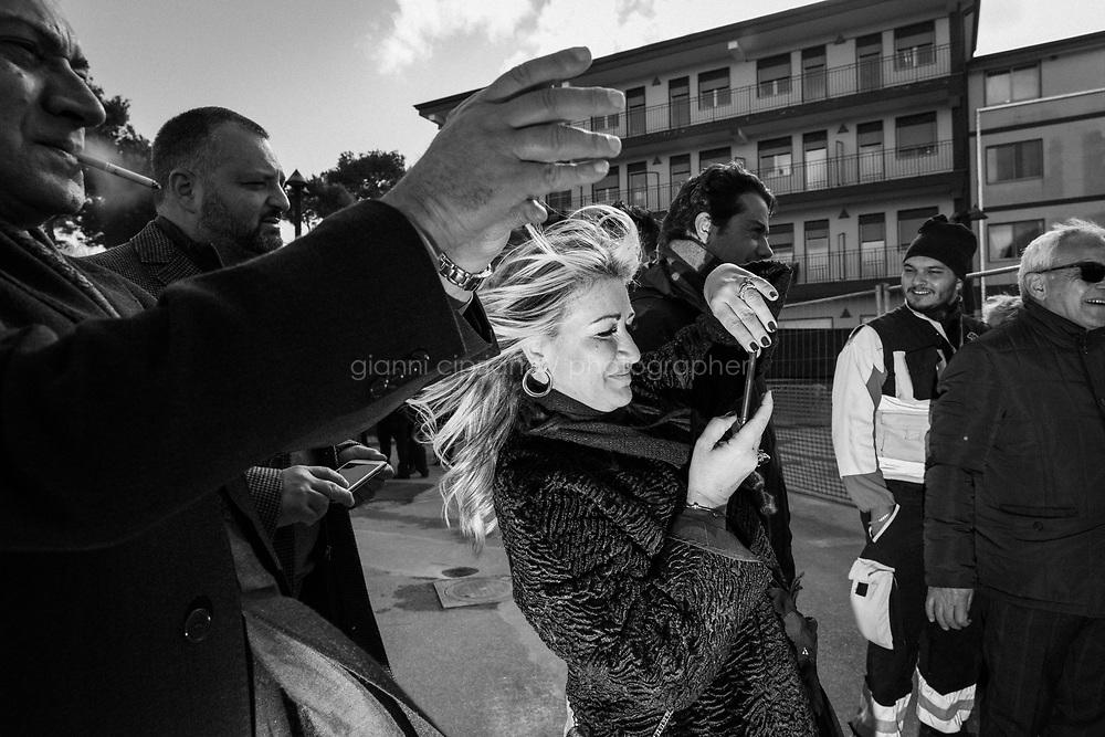 CASTELVOLTURNO (CE) - 3 FEBBRAIO 2018: Dei partecipanti fanno fotografie di grippo all'evento di apertura del cantiere per l'ampliamento della struttura ospedaliera dell'Ospedale Pineta Grande di Castelvolturno, inaugurato da Vincenzo De Luca (Partito Democratico), Presidente della Regione Campania ed ex sindaco di Salerno, a Castelvolturno (CE) il 3 febbraio 2018.<br /> <br /> Le elezioni politiche italiane del 2018 per il rinnovo dei due rami del Parlamento – il Senato della Repubblica e la Camera dei deputati – si terranno domenica 4 marzo 2018. Si voterà per l'elezione dei 630 deputati e dei 315 senatori elettivi della XVIII legislatura. Il voto sarà regolamentato dalla legge elettorale italiana del 2017, soprannominata Rosatellum bis, che troverà la sua prima applicazione<br /> <br /> ###<br /> <br /> CASTELVOLTURNO, ITALY - 3 FEBRUARY 2018: Participants take group pictures at the inauguration event for the opening of the construction site for the extension of the Pineta Grande Hospital of Castelvolturno, inaugurated by Vincenzo De Luca (Democratic Party / Partito Democratico), President of the Campania region and former mayor of Salerno, in Castelvolturno, Italy, on February 3rd 2018.<br /> <br /> The 2018 Italian general election is due to be held on 4 March 2018 after the Italian Parliament was dissolved by President Sergio Mattarella on 28 December 2017.<br /> Voters will elect the 630 members of the Chamber of Deputies and the 315 elective members of the Senate of the Republic for the 18th legislature of the Republic of Italy, since 1948.